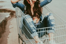 An image of a female carefree casual in a shopping cart.
